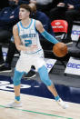 Charlotte Hornets guard LaMelo Ball (2) looks for room against the Dallas Mavericks defense during the second half of an NBA basketball game, Wednesday, Dec. 30, 2020, in Dallas. (AP Photo/Brandon Wade)