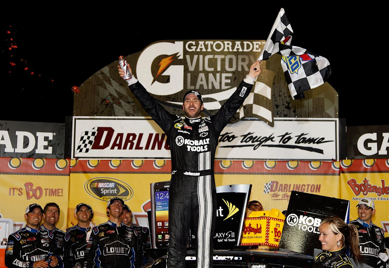 DARLINGTON, SC - MAY 12:  Jimmie Johnson, driver of the #48 Lowe's/Kobalt Tools Chevrolet, celebrates in Victory Lane after winning the NASCAR Sprint Cup Series Bojangles' Southern 500 at Darlington Raceway on May 12, 2012 in Darlington, South Carolina. This is the 200th win for Hendrick Motorsports.  (Photo by Todd Warshaw/Getty Images)