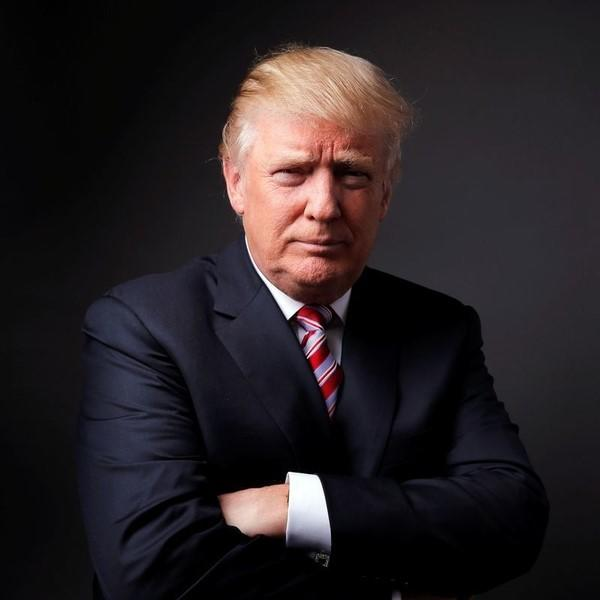 Republican U.S. presidential candidate Donald Trump poses for a photo after an interview with Reuters in his office in Trump Tower, in the Manhattan borough of New York City