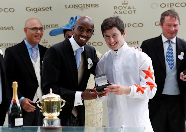 Horse Racing - Royal Ascot - Ascot Racecourse, Ascot, Britain - June 20, 2018 Mo Farah with winner of the 2.30 Queen Mary Stakes Oisin Murphy on Signora Cabello Action Images via Reuters/Paul Childs