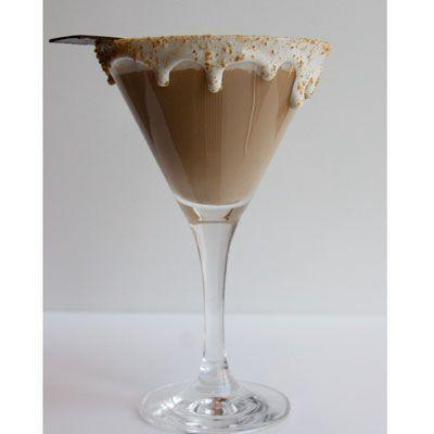 """<p>Two of your favorite things: s'mores and martinis come together in this cocktail. It's sweet and spicy, and will warm your guests right up.</p><p><em><a href=""""https://www.womansday.com/food-recipes/food-drinks/recipes/a33545/peninsula-chicago-smores-martini-recipe/"""" rel=""""nofollow noopener"""" target=""""_blank"""" data-ylk=""""slk:Get the S'mores Martini recipe."""" class=""""link rapid-noclick-resp"""">Get the S'mores Martini recipe. </a></em></p>"""