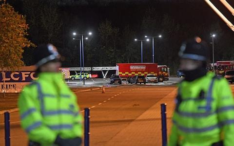 <span>Police on the scene while emergency services work outside the stadium</span> <span>Credit: PA </span>