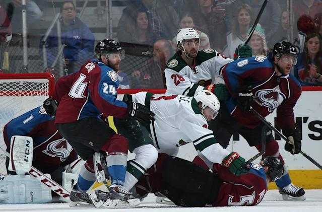 DENVER, CO - APRIL 26: Charlie Coyle #3 of the Minnesota Wild pins Cody McLeod #55 of the Colorado Avalanche to the ice as Matt Moulson #26 of the Minnesota Wild along with Semyon Varlamov #1, Marc-Andre Cliche #24 and Jan Hejda #8 of the Colorado Avalanche follow the play in the second period of Game Five of the First Round of the 2014 NHL Stanley Cup Playoffs at Pepsi Center on April 26, 2014 in Denver, Colorado. (Photo by Doug Pensinger/Getty Images)