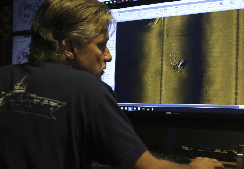 Rob Kraft, director of undersea operations at Vulcan Inc., reviews sonar scans of a warship from the World War II Battle of Midway that was found by the crew of the research vessel Petrel, Sunday, Oct. 20, 2019, off Midway Atoll in the Northwestern Hawaiian Islands. (AP Photo/Caleb Jones)