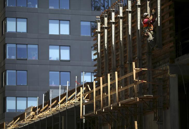 A worker labors on a housing project on Mission Street in the South of Market neighborhood in San Francisco