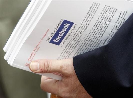 An investor holds prospectus explaining the Facebook stock after attending a show for Facebook's initial public offering at the Four Season's Hotel in Boston, May 8, 2012.