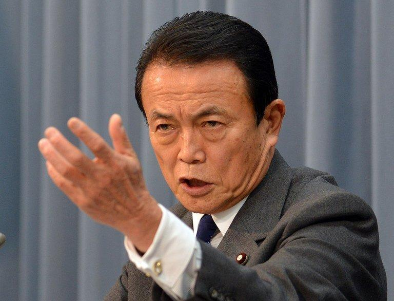 Japanese finance minister Taro Aso speaks at a press conference in Tokyo on Janaury 15, 2013
