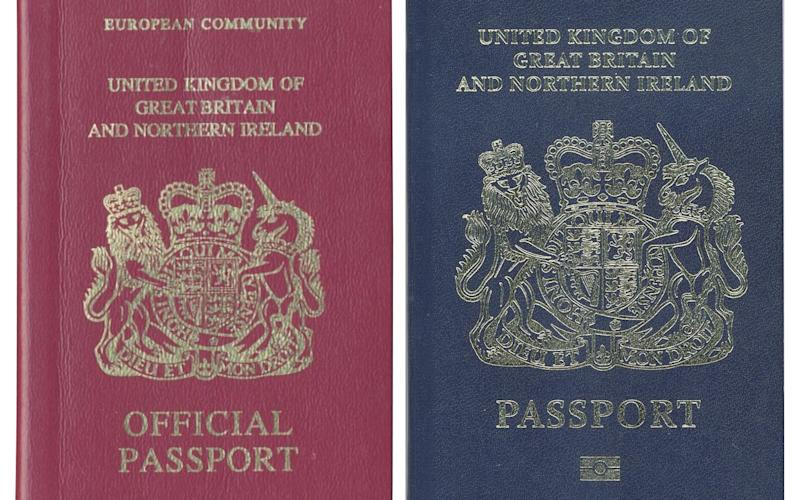 The iconic blue passport is set to make a return - AFP