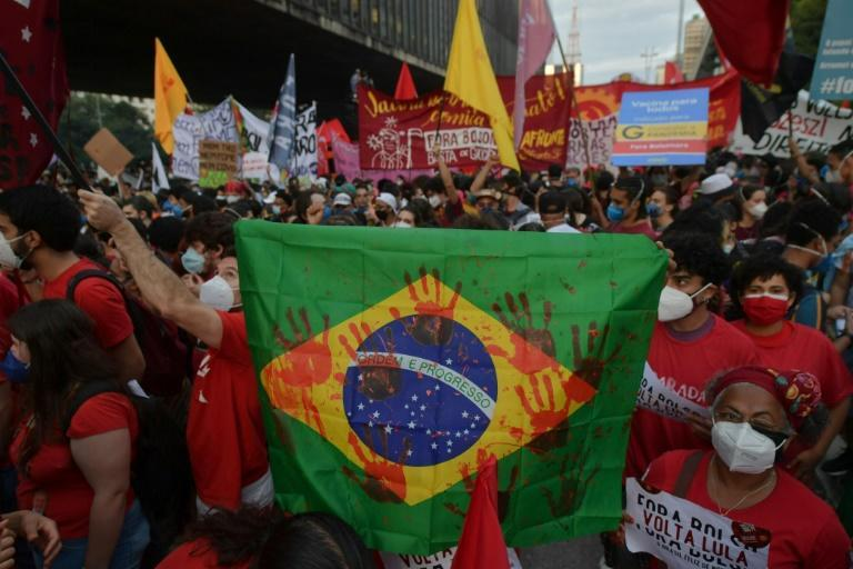 Marchers demonstrate against Brazilian President Jair Bolsonaro's handling of the COVID-19 pandemic in in Sao Paulo in late May 2021