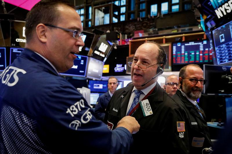Wall St opens flat as investors await Fed decision
