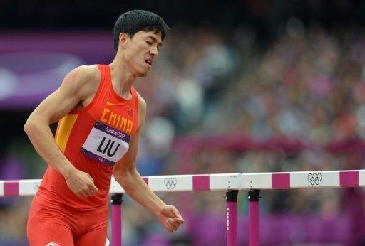 Liu Xiang eventually got up and hopped down the track to be embraced by his fellow competitors
