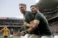 South Africa's centre Jean de Villiers (L) celebrates after scoring a try during a Four Nations tournament rugby union match against Australia, at the Newlands stadium in Cape Town, on September 27, 2014 (AFP Photo/Marco Longari)
