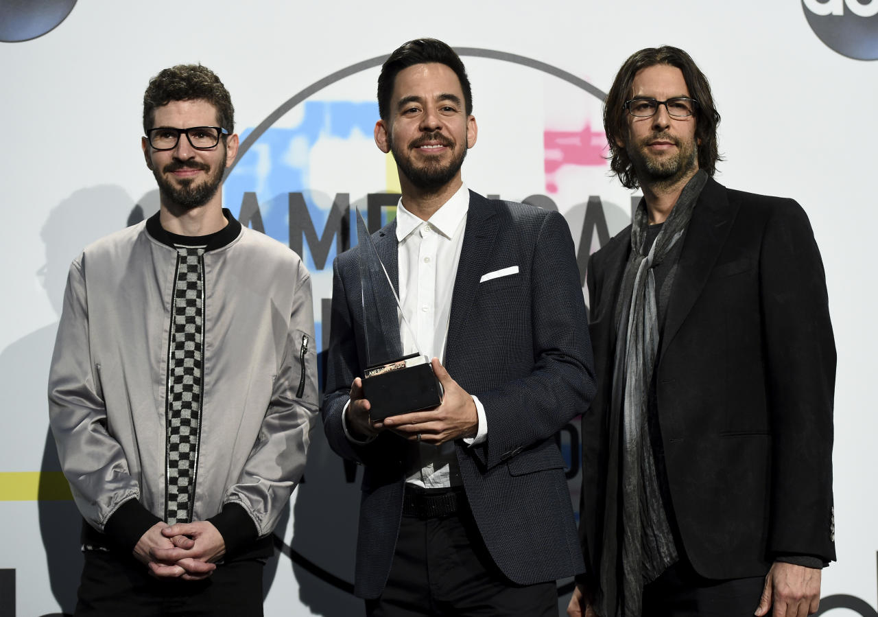 Brad Delson, from left, Mike Shinoda, and Rob Bourdon of Linkin Park pose in the press room with the award for favorite artist alternative rock at the American Music Awards at the Microsoft Theater on Sunday, Nov. 19, 2017, in Los Angeles. (Photo by Jordan Strauss/Invision/AP)