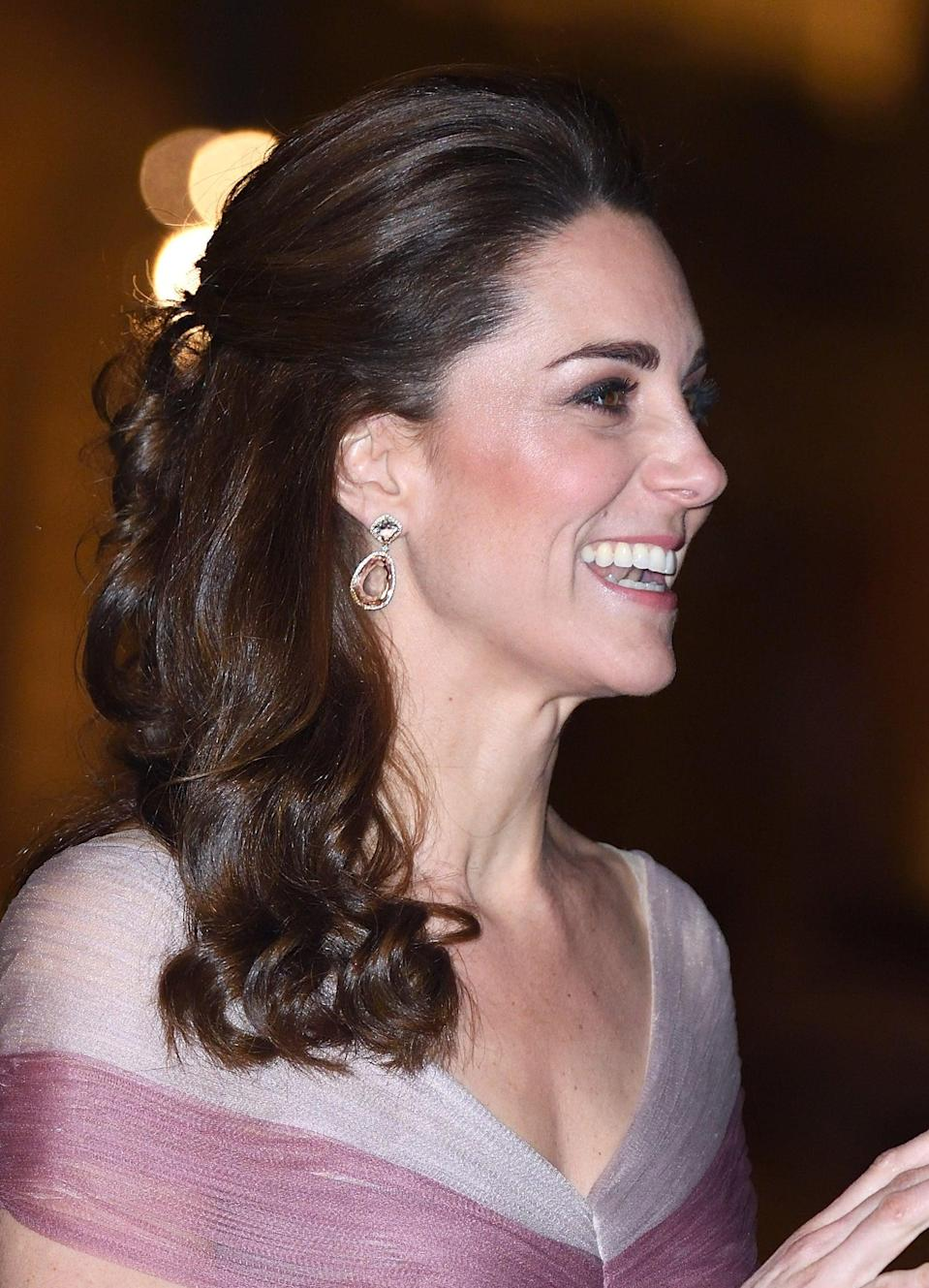 <p>For a night out at the 100 Women In Finance Gala Dinner at the Victoria and Albert Museum, Middleton wore a half-up ponytail featuring tighter curls than we're used to seeing from her. </p>