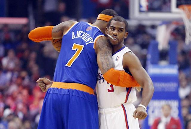 New York Knicks' Carmelo Anthony, left, and Los Angeles Clippers' Chris Paul, right, embrace before an NBA basketball game in Los Angeles, Wednesday, Nov. 27, 2013. (AP Photo/Danny Moloshok)