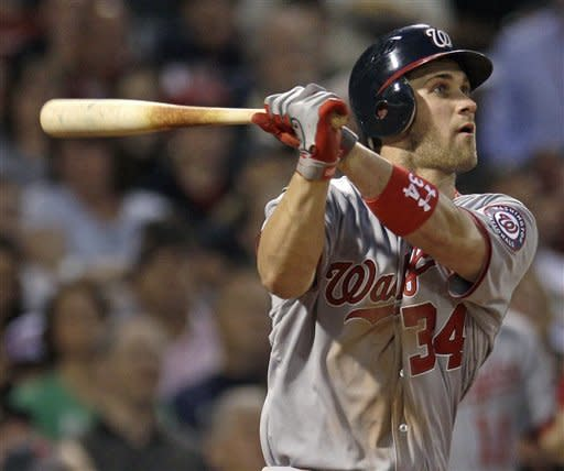 Washington Nationals' Bryce Harper watches the flight of his two-run home run off Boston Red Sox starting pitcher Felix Doubront during the fourth inning of a baseball game at Fenway Park, Friday, June 8, 2012, in Boston. (AP Photo/Charles Krupa)