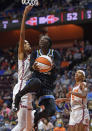 Chicago Sky guard Kahleah Copper drives to the basket as Connecticut Sun forward DeWanna Bonner defends defends during a WNBA semifinal playoff basketball game, Tuesday, Sept. 28, 2021, at Mohegan Sun Arena in Uncasville, Conn. (Sean D. Elliot/The Day via AP)
