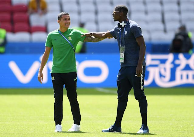 <p>Tim Cahill and Paul Pogba catch up ahead of the Group C clash </p>