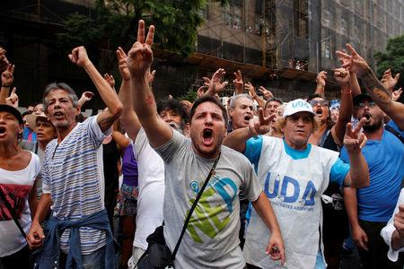Protesters yells slogans during a march of Argentina's National General Confederation of Labor (CGT) in solidarity with striking teachers in Buenos Aires