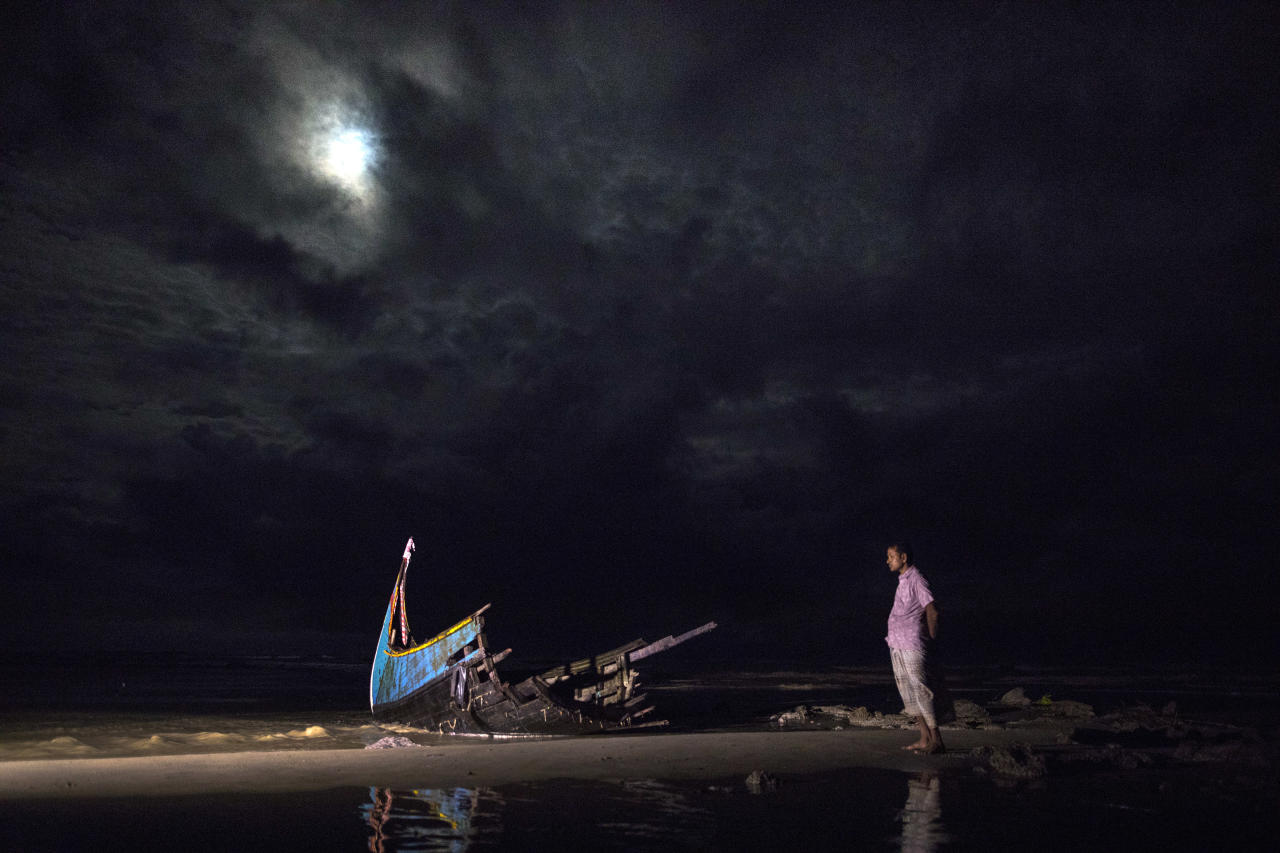 <p>A destroyed boat is seen on a beach washed up after it sunk in rough seas off the coast of Bangladesh carrying over 100 people. Seventeen survivors were found along with the bodies of 15 women and children. Over 500 Rohingya refugees have fled into Bangladesh since late August during the outbreak of violence. (Paula Bronstein/Getty Images) </p>