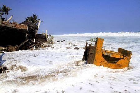 Buildings damaged by high waves are seen in Coyuca de Benitez, on the coast of Guerrero state, Mexico, in this May 4, 2015 file photo.REUTERS/Claudio Vargas