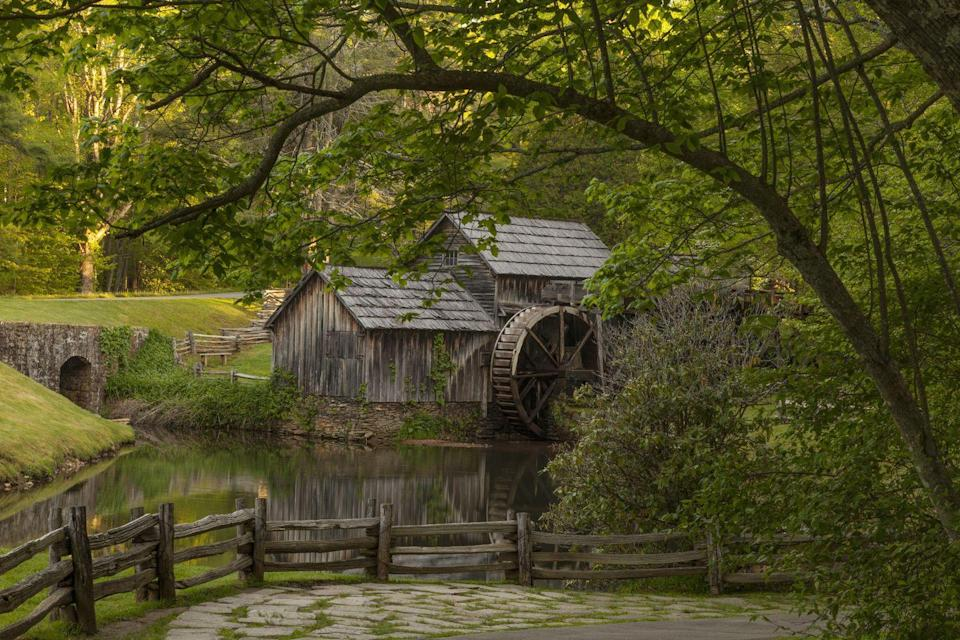 """<p>Located off the scenic Blue Ridge Parkway at milepost 176.1, <a href=""""http://www.virtualblueridge.com/parkway-place/mabry-mill/"""" rel=""""nofollow noopener"""" target=""""_blank"""" data-ylk=""""slk:Mabry Mill"""" class=""""link rapid-noclick-resp"""">Mabry Mill</a> stands rustic and proud — and rightfully so, as the location is perhaps one of the most-photographed in America. The historic mill, built by Edwin Boston Mabry in the 1800s, has been restored so visitors can enjoy live exhibits and demonstrations of the milling process. During summer Sunday afternoons, the mill also comes alive with musicians and dancers.</p>"""