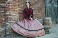 """<p>Lucy's Lincoln-era ballgown """"had a certain impact because the rose and the maroon [represents] what actually happens to her — it's like your heart, blood,"""" Mari-An Ceo explains. """"She's been put into this position of high drama."""" (Photo by: Sergei Bachlakov/NBC) </p>"""