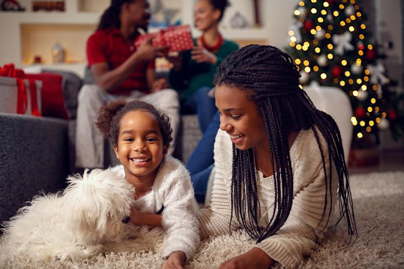 The holiday season is the perfect time to bond with your new pet by playing with them, taking walks and socializing them. (Photo: Getty Creative)