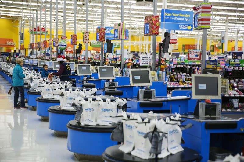 FILE PHOTO: Employees work at the checkout counters of a Walmart store in Secaucus, New Jersey