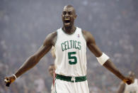 FILE - In this May 6, 2008, file photo, Boston Celtics' Kevin Garnett gestures to the crowd just before tipoff in Game 1 of an NBA Eastern Conference semifinal basketball series against the Cleveland Cavaliers in Boston. Kobe Bryant, Tim Duncan and Kevin Garnett. Each was an NBA champion, an MVP, an Olympic gold medalist, annual locks for All-Star and All-Defensive teams. And now, the ultimate honor comes their way: On Saturday night, May 15, 2021, in Uncasville, Connecticut, they all officially become members of the Naismith Memorial Basketball Hall of Fame.(AP Photo/Winslow Townson, File)