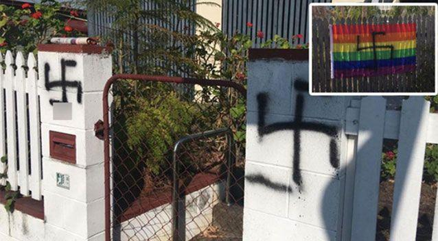 A Queensland woman woke up to find her rainbow flags spray painted with swastikas.