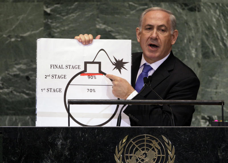 """FILE - In this Sept. 27, 2012 file photo, Israeli Prime Minister Benjamin Netanyahu shows an illustration as he describes his concerns over Iran's nuclear ambitions during his address to the 67th session of the United Nations General Assembly at U.N. headquarters. Iran is considering a more confrontational strategy at possible renewed nuclear talks with world powers, threatening to boost levels of uranium enrichment unless the West makes clear concessions to ease sanctions. Such a gambit outlined by senior Iranian officials in interviews could push Iran's atomic program far closer to Israel's """"red line."""" (AP Photo/Richard Drew, File)"""