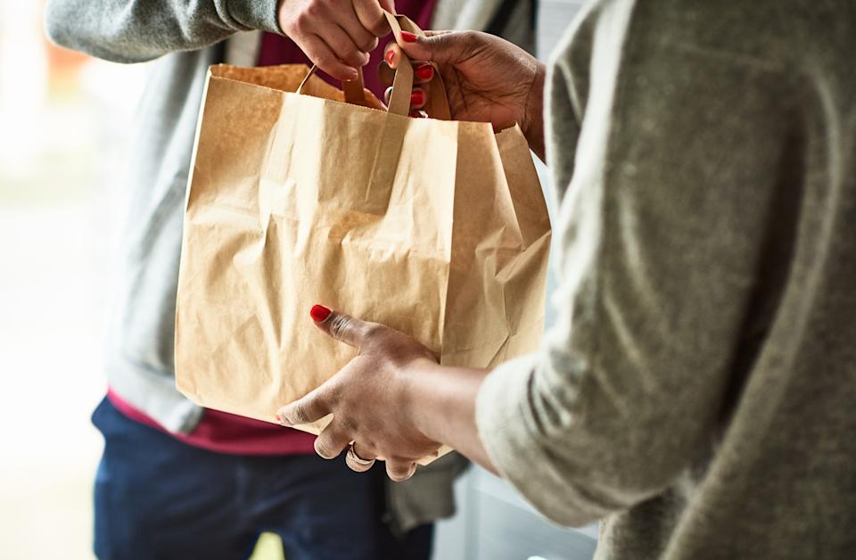 Restaurant workers make it possible for more people to shelter in place, by putting themselves on the front lines of the pandemic every day. (Getty Images)
