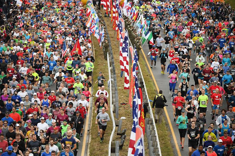 Runners are seen at the start of the annual Marine Corps Marathon on Oct. 28, 2018 in Arlington, Virginia. (Matt McClain/The Washington Post via Getty Images)