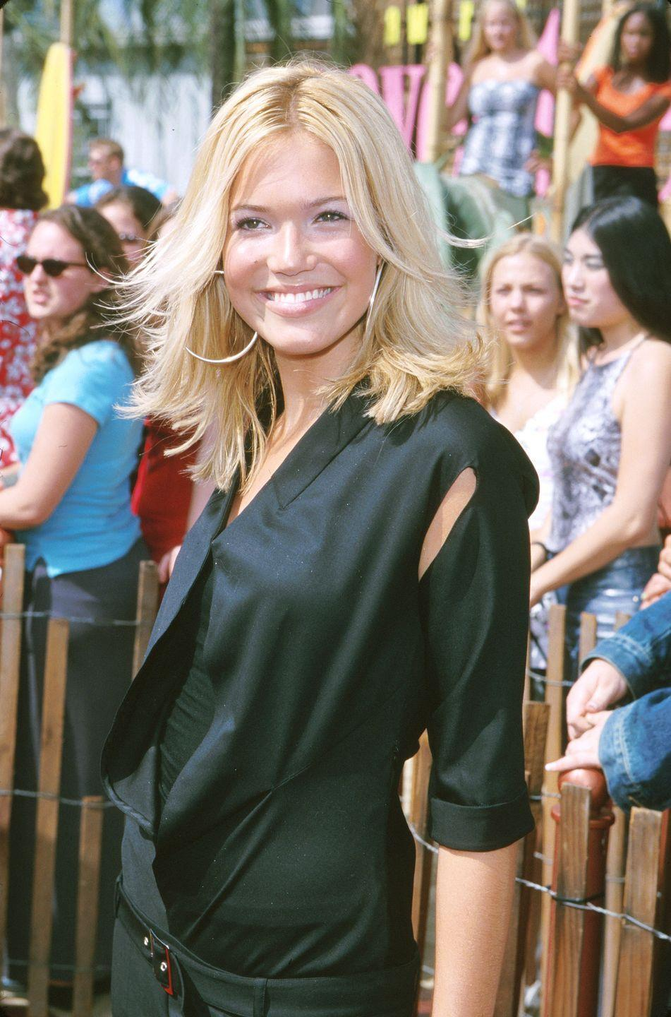 <p>Here, Mandy Moore models the highly popular flipped blowout, which took over red carpets in the early aughts. The beachy look appeared effortless, but actually required <em>a lot </em>of styling. </p>