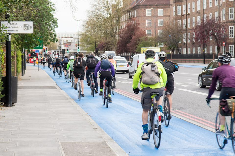 London, England - April 14, 2016: Cyclists using the newly opened segregated Cycle Superhighway at Kennington Oval in South London.