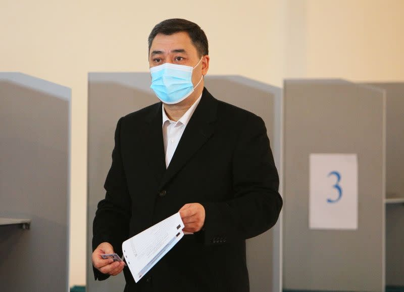 Presidential candidate Japarov casts his ballot during a presidential election and constitutional referendum in Bishkek
