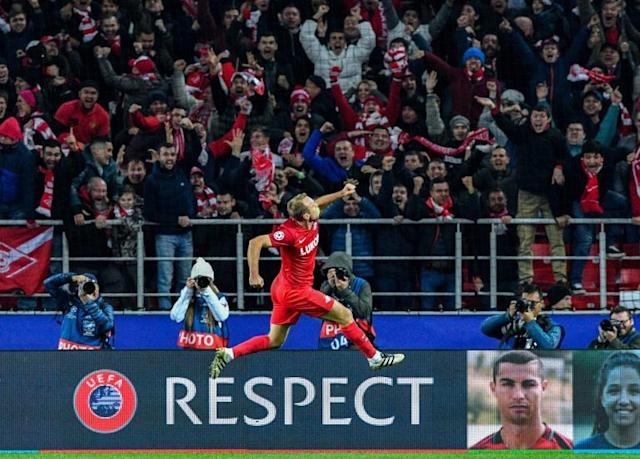 Spartak Moscow's Denis Glushakov celebrates after scoring a goal during their UEFA Champions League match against Sevilla FC at the Otkrytie Arena stadium in Moscow on October 17, 2017