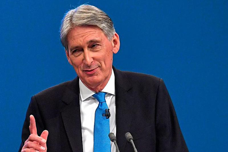 Philip Hammond is expected to pledge to build another 300,000 new homes every year: Getty Images
