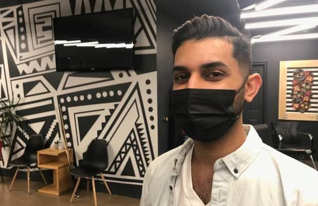 Mandip Garcha says he realized his dream of becoming a barber with a lot of help from the folks at 1949 Barbershop. Garcha now works at the shop's second location in St. John's.  (Paula Gale/CBC  - image credit)
