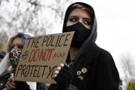 A demonstrator holds a poster during a 'Kill the Bill' protest at Hyde Park in London, Saturday, April 3, 2021. The demonstration is against the contentious Police, Crime, Sentencing and Courts Bill, which is currently going through Parliament and would give police stronger powers to restrict protests. (AP Photo/Alberto Pezzali)