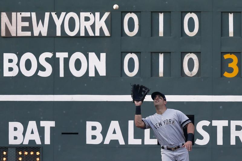 New York Yankees' Mike Tauchman makes the catch on the fly out by Boston Red Sox's Jackie Bradley Jr. to end the fourth inning of a baseball game in Boston, Saturday, July 27, 2019. (AP Photo/Michael Dwyer)