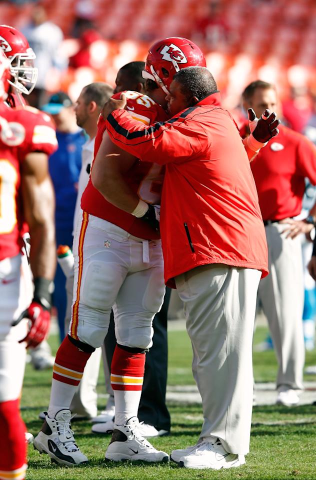 KANSAS CITY, MO - DECEMBER 02:  Head coach Romeo Crennel of the Kansas City Chiefs receives a hug from center Ryan Lilja #65 during player warm-ups prior to the game against the Carolina Panthers at Arrowhead Stadium on December 2, 2012 in Kansas City, Missouri.  (Photo by Jamie Squire/Getty Images)