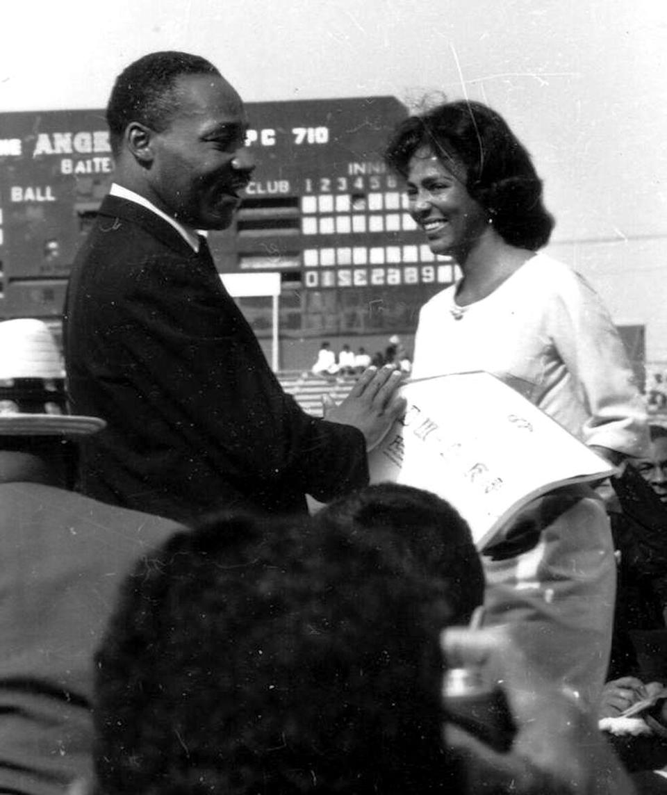 <p>Dandridge greets Dr. Martin Luther King Jr. at Wrigley Field. The actress joined the civil rights leader as he addressed a crowd during a peaceful protest. </p>