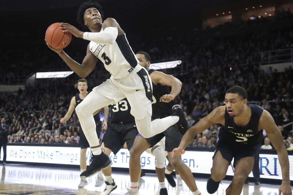 Providence guard David Duke (3) looks to shoot next to Butler guard Aaron Thompson (2) during the second half of an NCAA college basketball game Friday, Jan. 10, 2020, in Providence, R.I. Butler won 70-58. (AP Photo/Elise Amendola)