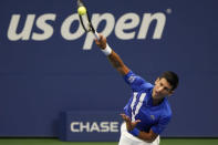 Novak Djokovic, of Serbia, serves to Damir Dzumhur, of Bosnia and Herzegovina, during the first round of the US Open tennis championships, Monday, Aug. 31, 2020, in New York. (AP Photo/Frank Franklin II)