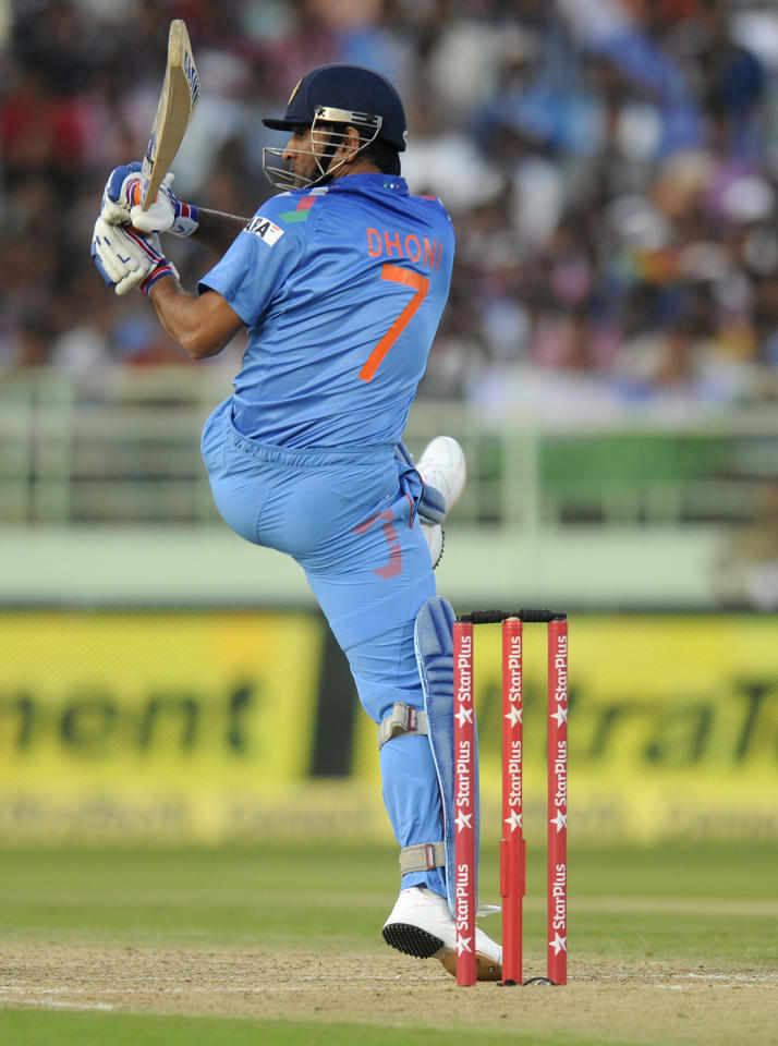 Mahendra Singh Dhoni captain of India  bats during the second Star Sports One Day International (ODI) match between India and The West Indies held at the Dr. Y.S. Rajasekhara Reddy ACA-VDCA Cricket Stadium, Vishakhapatnam, India on the 24th November 2013  Photo by: Pal Pillai - BCCI - SPORTZPICS   Use of this image is subject to the terms and conditions as outlined by the BCCI. These terms can be found by following this link:  https://ec.yimg.com/ec?url=http%3a%2f%2fsportzpics.photoshelter.com%2fgallery%2fBCCI-Image-Terms%2fG0000ahUVIIEBQ84%2fC0000whs75.ajndY&t=1506209943&sig=3NPZZpwEIQvwuKl7klxySQ--~D