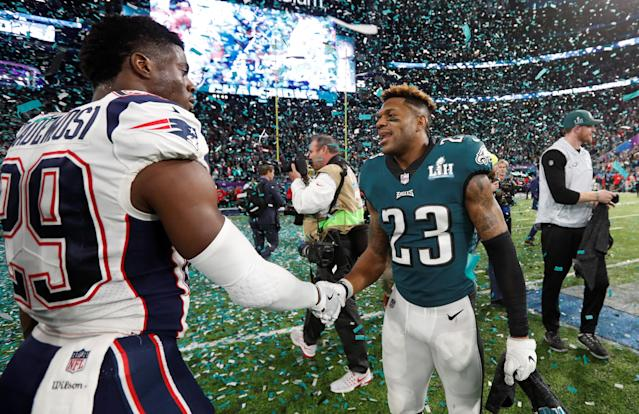 NFL Football - Philadelphia Eagles v New England Patriots - Super Bowl LII - U.S. Bank Stadium, Minneapolis, Minnesota, U.S. - February 4, 2018 Philadelphia Eagles' Rodney McLeod shakes hands with New England Patriots' Johnson Bademosi after the game REUTERS/Kevin Lamarque