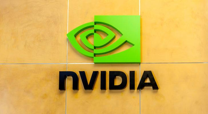 Nvidia (NVDA) logo on the indoor wall of a corporate building made of yellow tiles
