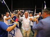 Supporters of Israeli Prime Minister Benjamin Netanyahu's Likud party react to exit polls in Israel's parliamentary election at the party headquarters in Tel Aviv